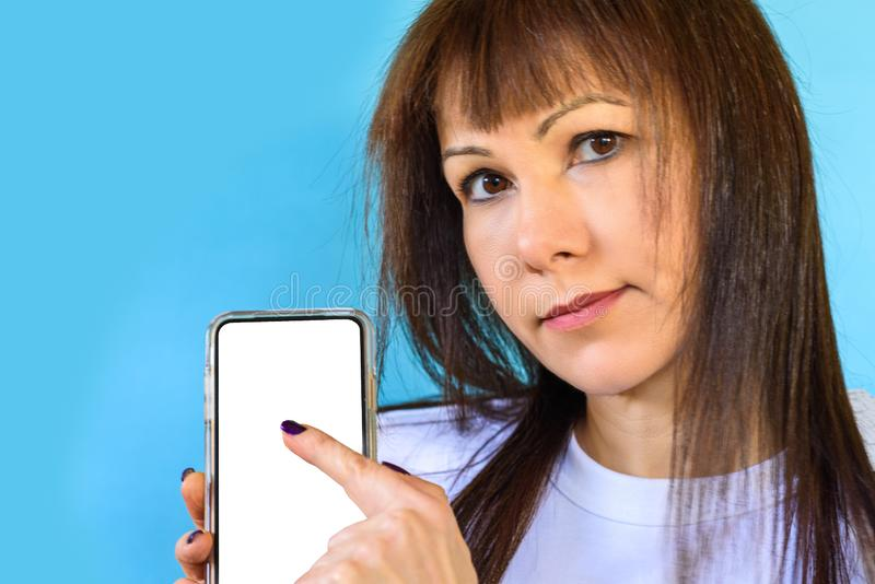 Closeup of woman using smartphone. Mock up mobile phone white color blank screen. royalty free stock photography