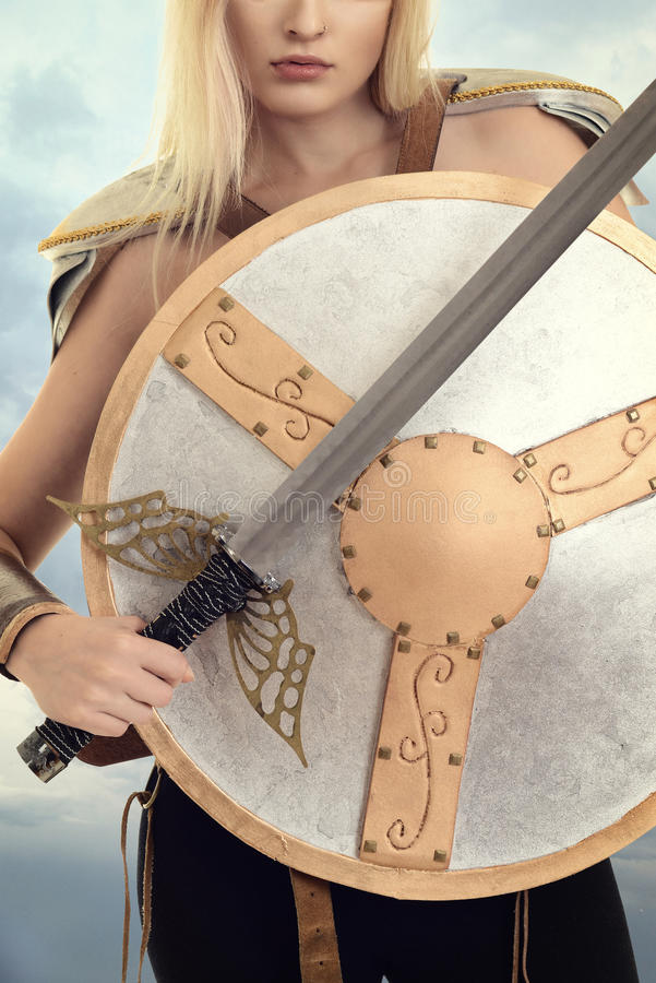 Closeup woman warrior with shield and sword royalty free stock images