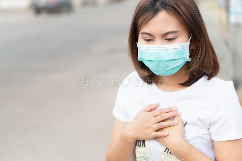 Closeup woman wearing face mask for protect air polution, health care and medical concept. Closeup woman wearing face mask for protect air polution, health care stock photography