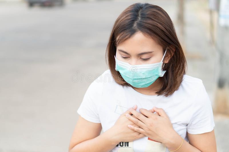 Closeup woman wearing face mask for protect air polution, health care and medical concept. Closeup woman wearing face mask for protect air polution, health care stock photo