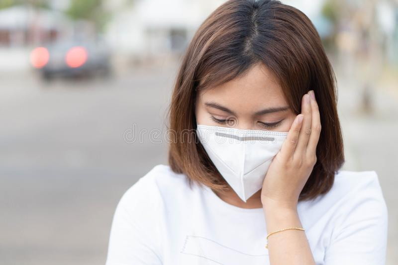 Closeup woman wearing face mask for protect air polution, health care and medical concept. Closeup woman wearing face mask for protect air polution, health care royalty free stock images