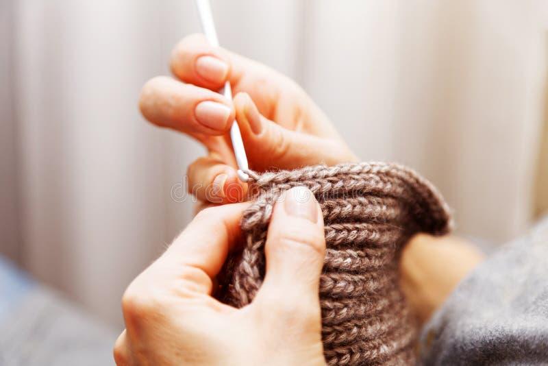 Closeup womans hands knitting wool yarn royalty free stock image