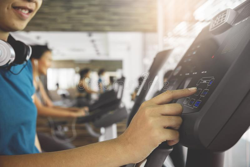 Closeup woman hand using exercise bike stock photos