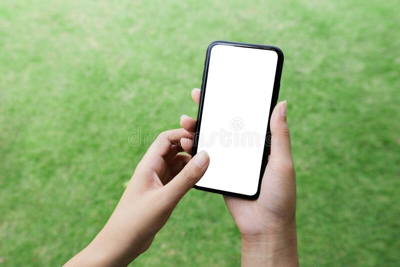 Closeup women hand using smart phone white screen royalty free stock photography