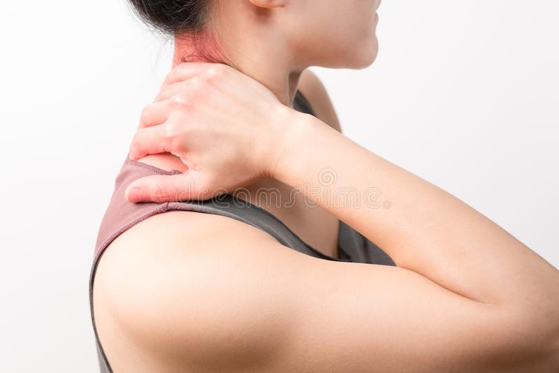 Closeup women neck and shoulder pain/injury with red highlights on pain area with white background, healthcare and medical concept. Closeup woman neck and royalty free stock image