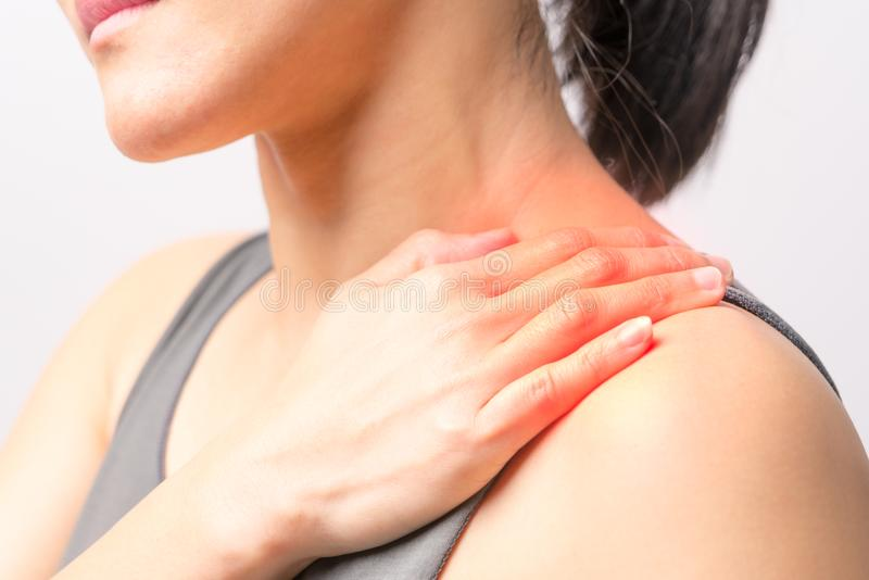 Closeup women neck and shoulder pain/injury with red highlights on pain area with white background, healthcare and medical concept. Closeup woman neck and stock photos