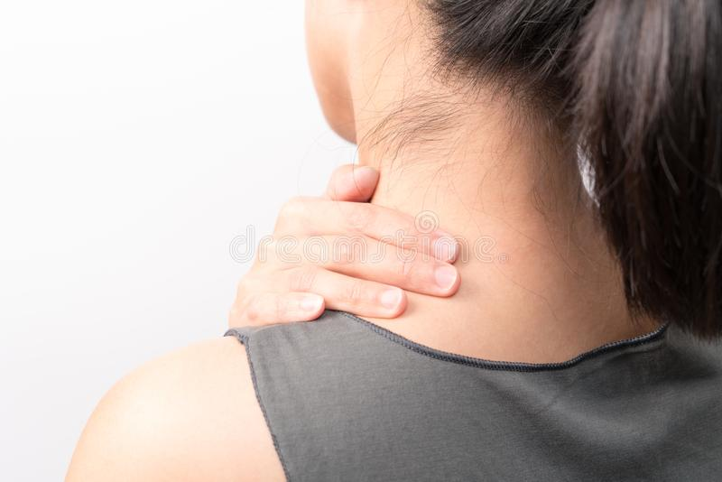 Closeup women neck and shoulder pain/injury with red highlights on pain area with white background, healthcare and medical concept. Closeup woman neck and stock photography