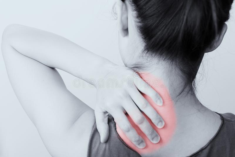 Closeup women neck and shoulder pain/injury with red highlights on pain area with white backgrounds, healthcare and medical. Closeup woman neck and shoulder pain stock photo