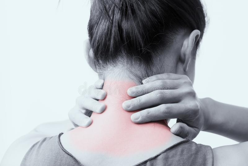Closeup women neck and shoulder pain/injury with red highlights on pain area with white backgrounds, healthcare and medical. Closeup woman neck and shoulder pain royalty free stock photo