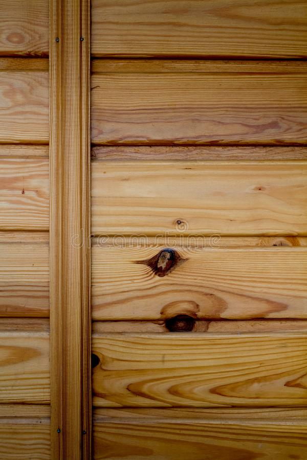 Closeup of wooden boards fastened by a cross bar, the theme of environmental friendliness. Closeup of wooden boards fastened by a cross bar, background or royalty free stock image