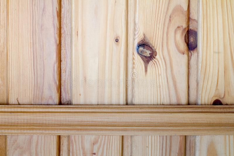 Closeup of wooden boards fastened by a cross bar, the theme of environmental friendliness. Closeup of wooden boards fastened by a cross bar, background or royalty free stock photos