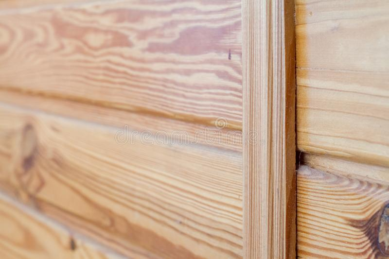 Closeup of wooden boards fastened by a cross bar, the theme of environmental friendliness. Closeup of wooden boards fastened by a cross bar, background or royalty free stock images