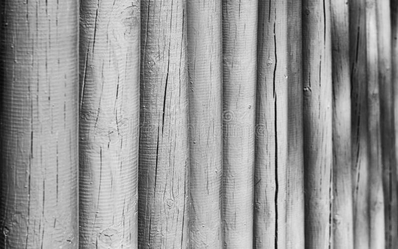 Closeup of a wooden fence with selective focus. Closeup of a wooden fence, weathered and rough textured, suitable to be used as background. Selective focus stock images