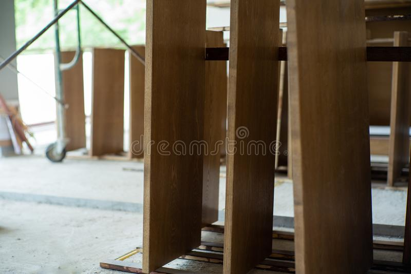 Closeup wooden plates at the factory waiting for installation. Vintage handyman work in workshop.  royalty free stock image