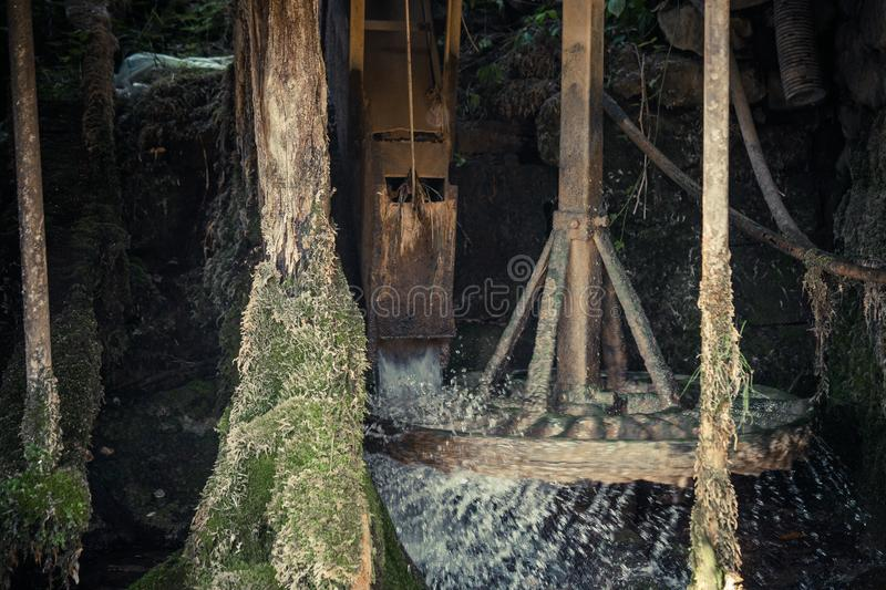 Closeup of working traditional water mill wheel stock image