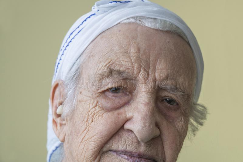 Closeup wrinkled face of a thoughtful senior woman stock images