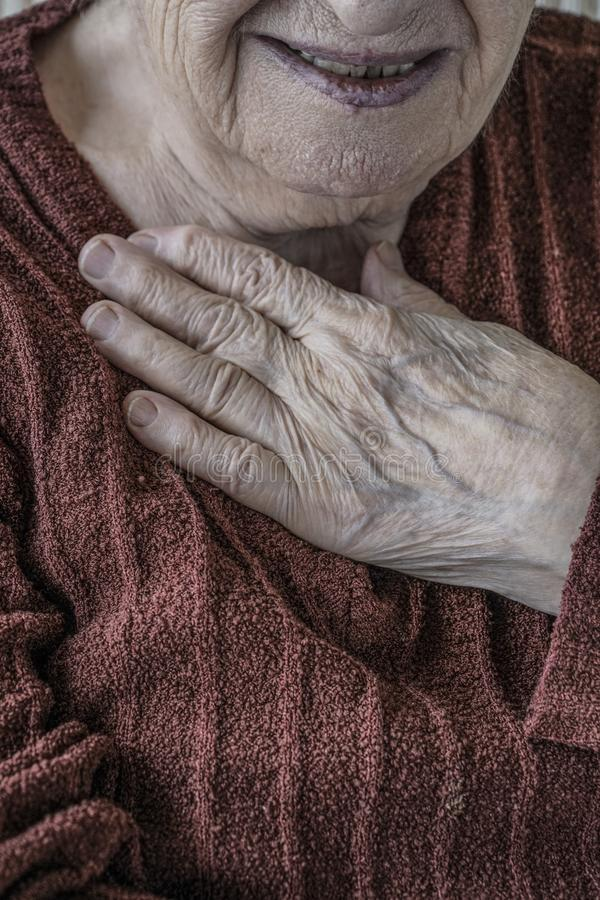 Closeup wrinkled hand of a senior person royalty free stock photography