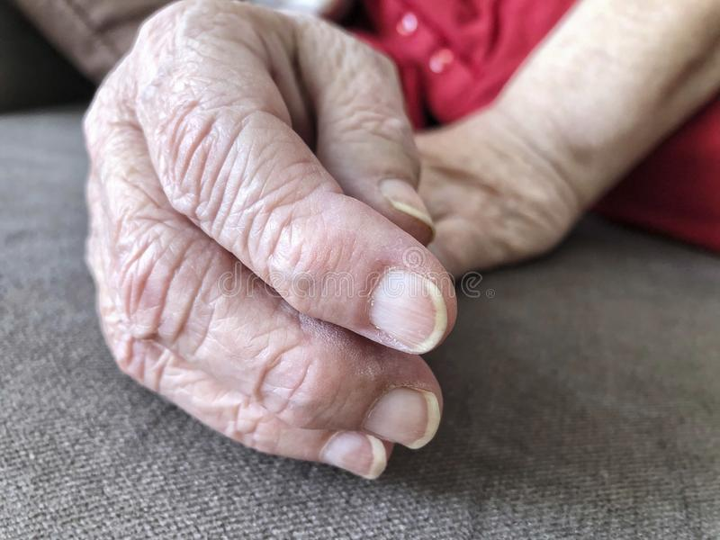 Closeup wrinkled hands of an old woman royalty free stock photography