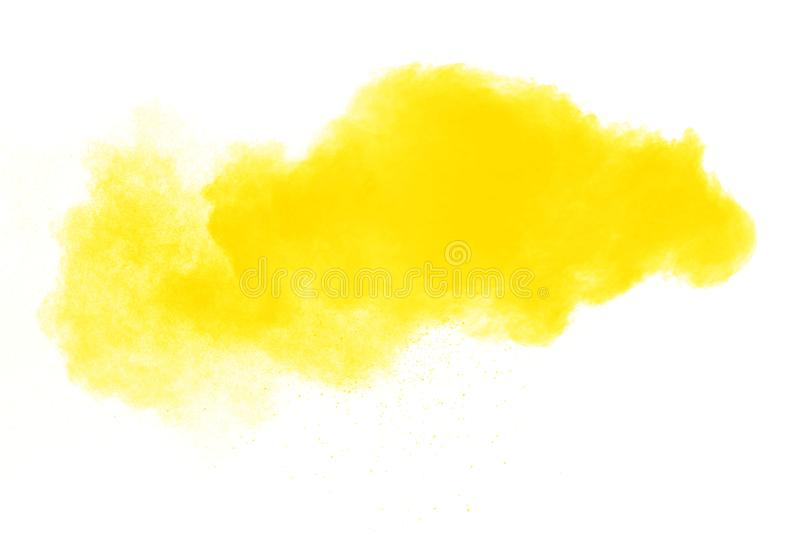 Closeup of yellow dust particles splash isolated on background. Yellow color powder explosion cloud isolated on white background.Closeup of yellow dust royalty free stock images