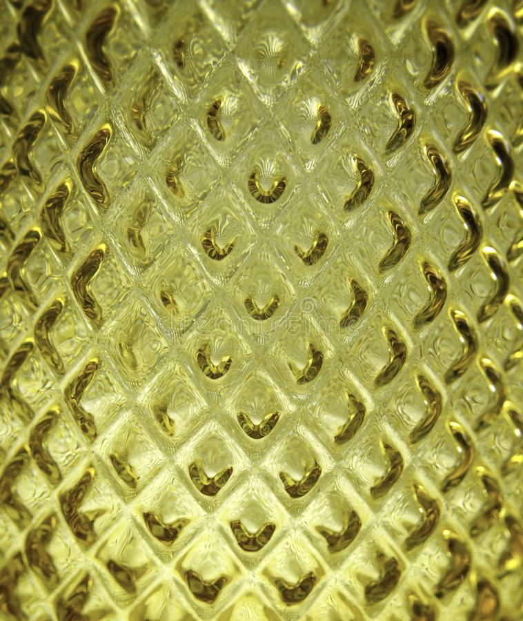 Closeup of a yellow glass vase texture surface. Diamond shaped. Interior decoration stock photography