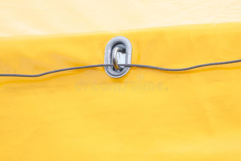 Yellow tarpaulin made of waterproof material, detail of truck. Closeup of yellow tarpaulin made of waterproof material, detail of truck stock photography