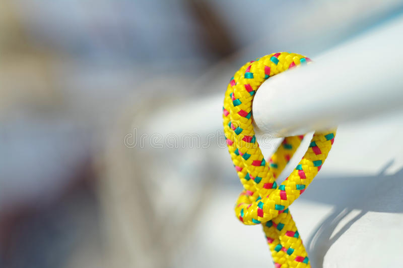 Closeup of yellow thin short rope used for yacht purposes royalty free stock image