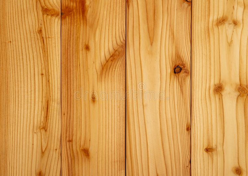 Closeup yellow wood texture background. Wood texture with unique pattern royalty free stock images