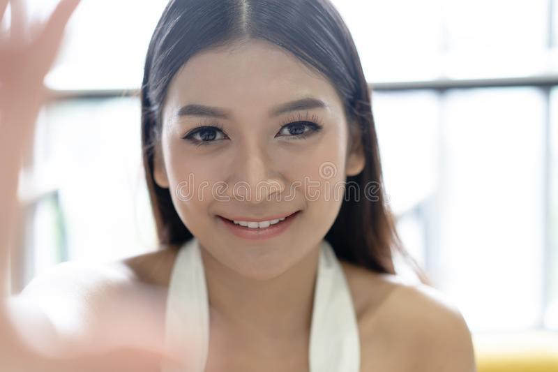 Closeup Young Asian woman take selfie from hands with phone in her office. Concept business woman lifestyle happy stock photos