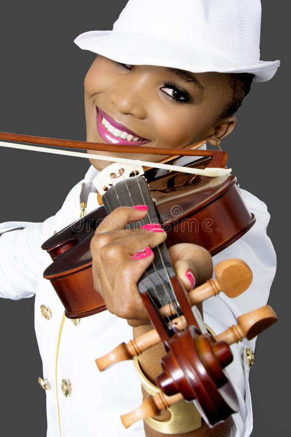 Closeup of Young Beautiful African Woman Playing Violin royalty free stock photo