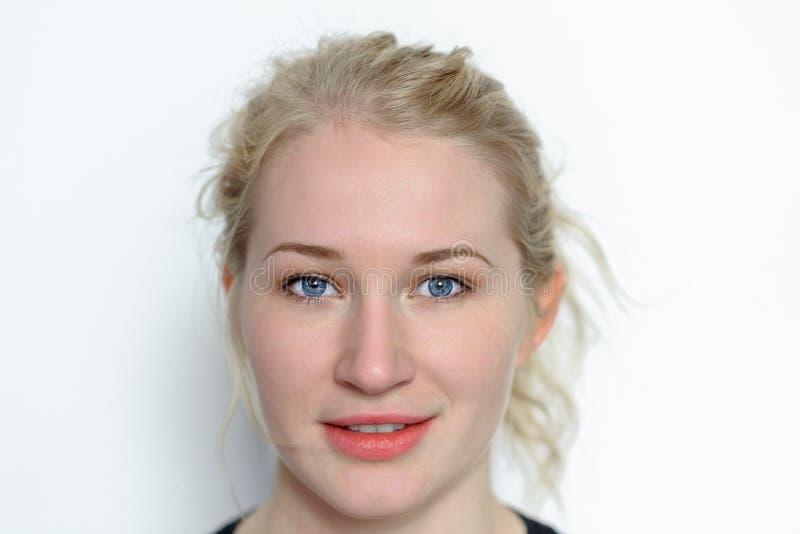 Closeup of young blond beautiful woman stock photos