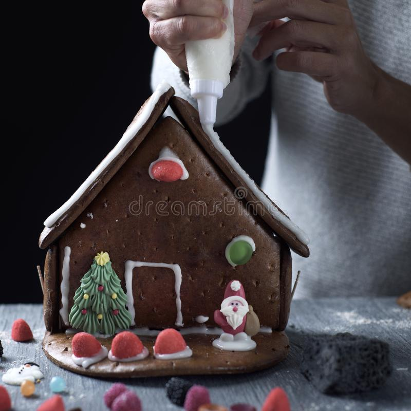 Young man making a gingerbread house stock photos