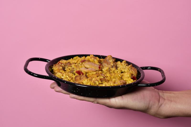 Man with a typical spanish paella valenciana stock images