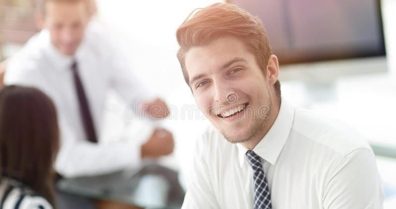 Closeup.young employee of the company stock photo