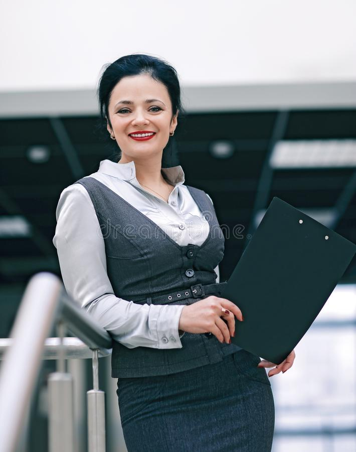 Closeup of a young employee with documents stock photography