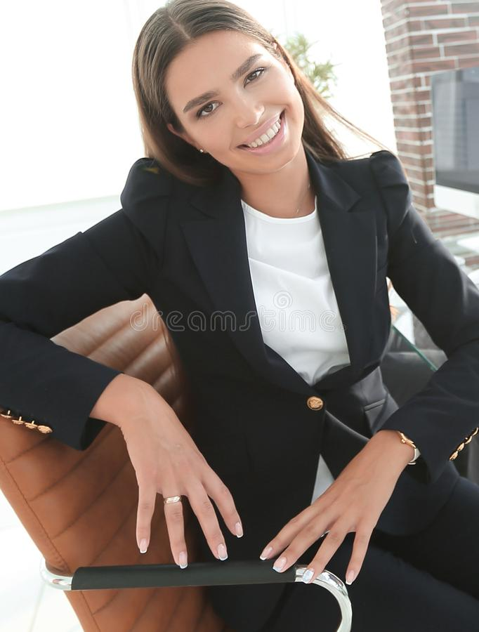 Young employee sitting at a Desk. Closeup of a young employee sitting at a Desk royalty free stock photography