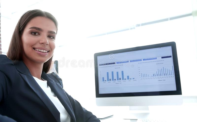 Young employee sitting at a Desk. Closeup of a young employee sitting at a Desk royalty free stock photo