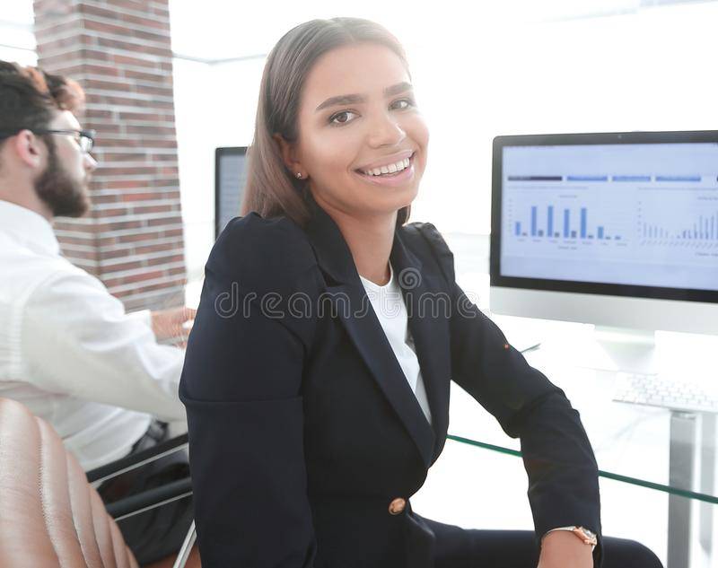 Young employee sitting at a Desk. Closeup of a young employee sitting at a Desk stock photography