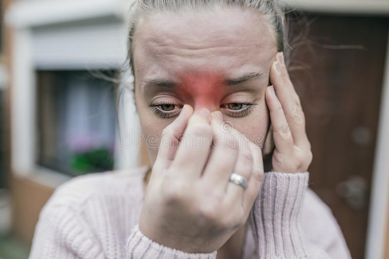 Sinus ache causing very paintful headache. Unhealthy woman in p stock images