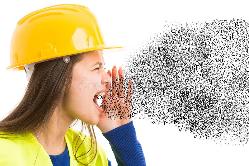 Closeup of female builder shouting concept stock photography