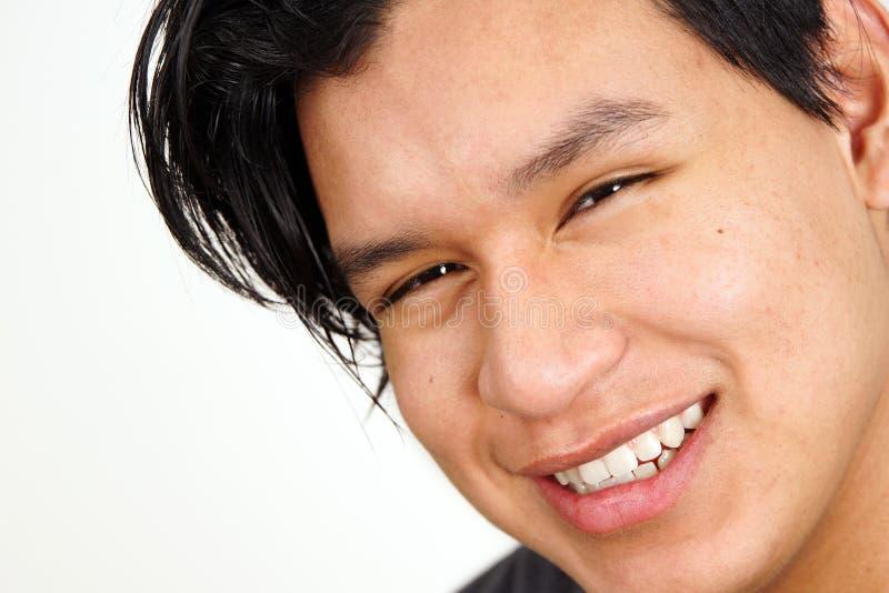 Closeup of young latino man smiling stock images