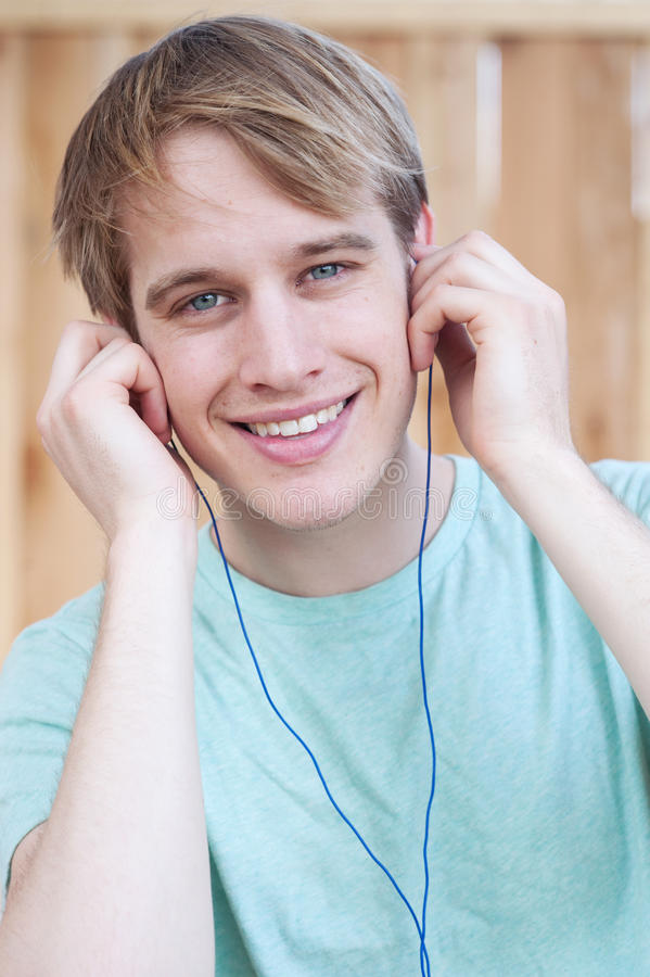 Closeup of young male listening to music royalty free stock photos