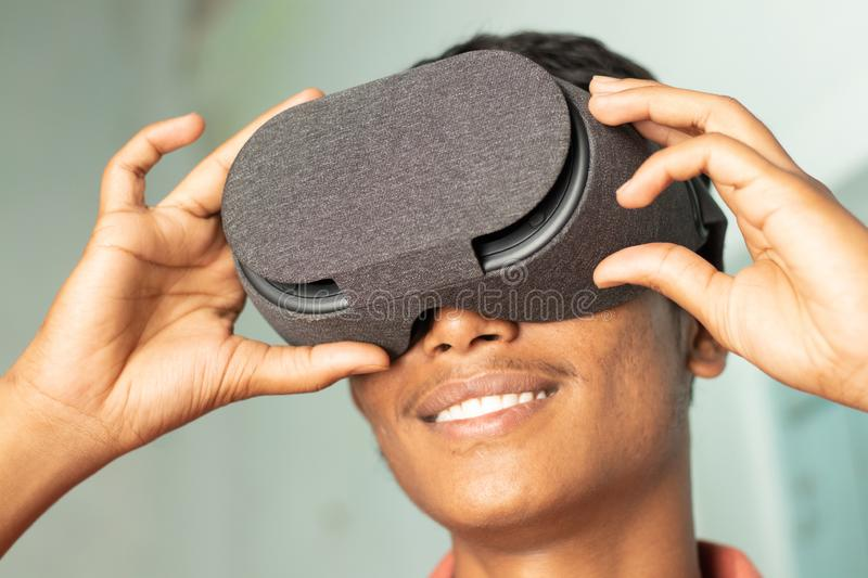 Closeup of a young man experiencing virtual reality through a VR headset. Closeup of a young man experiencing virtual reality through a VR headset royalty free stock photography