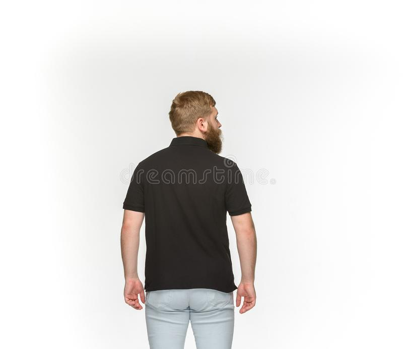 Closeup of young man`s body in empty black t-shirt isolated on white background. Mock up for disign concept stock photos