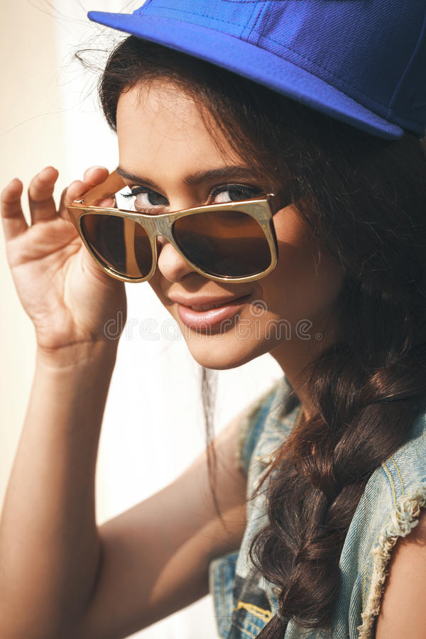 Closeup of Young woman in sunglasses stock photography