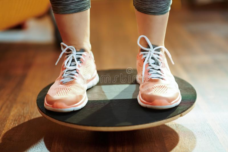 Closeup on sports woman while training using balance board stock images