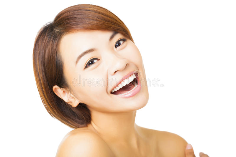 Closeup young woman face on white background stock images