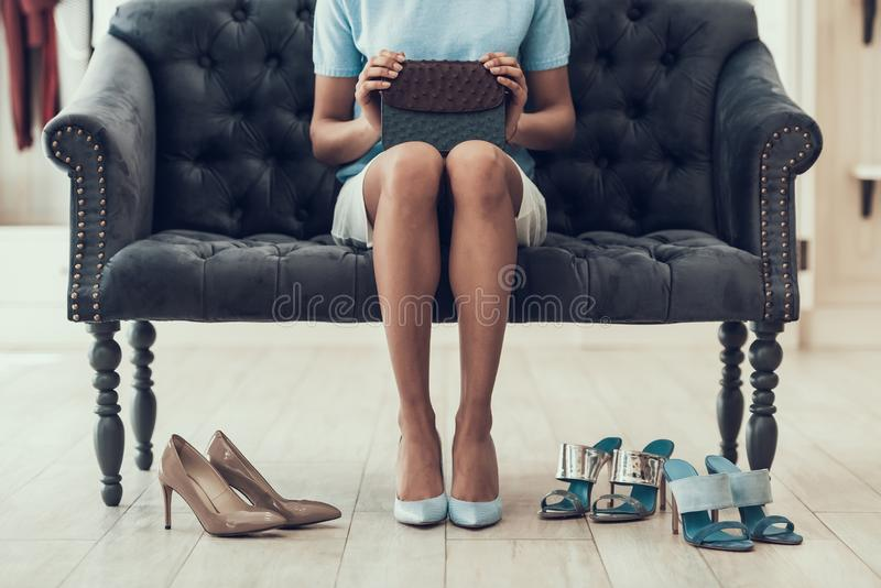 Closeup of Young Woman trying on Shoes in Store royalty free stock photos