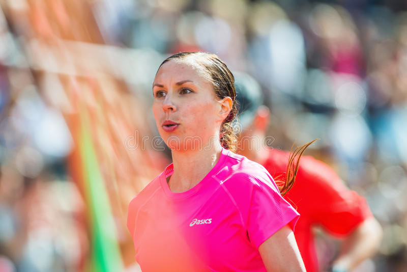 Closeup of a young womans face with blurred background at the final stretch at Stockholm Stadion stock photo