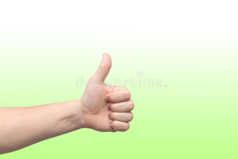 Closeupen av den manliga handen, tecknet är allt bra arkivfoton