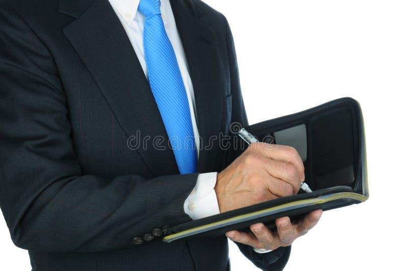 Att ta för affärsman noterar arkivbild